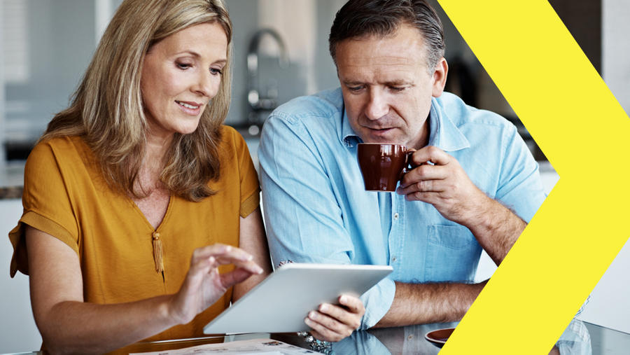 Man and woman in meeting looking at iPad