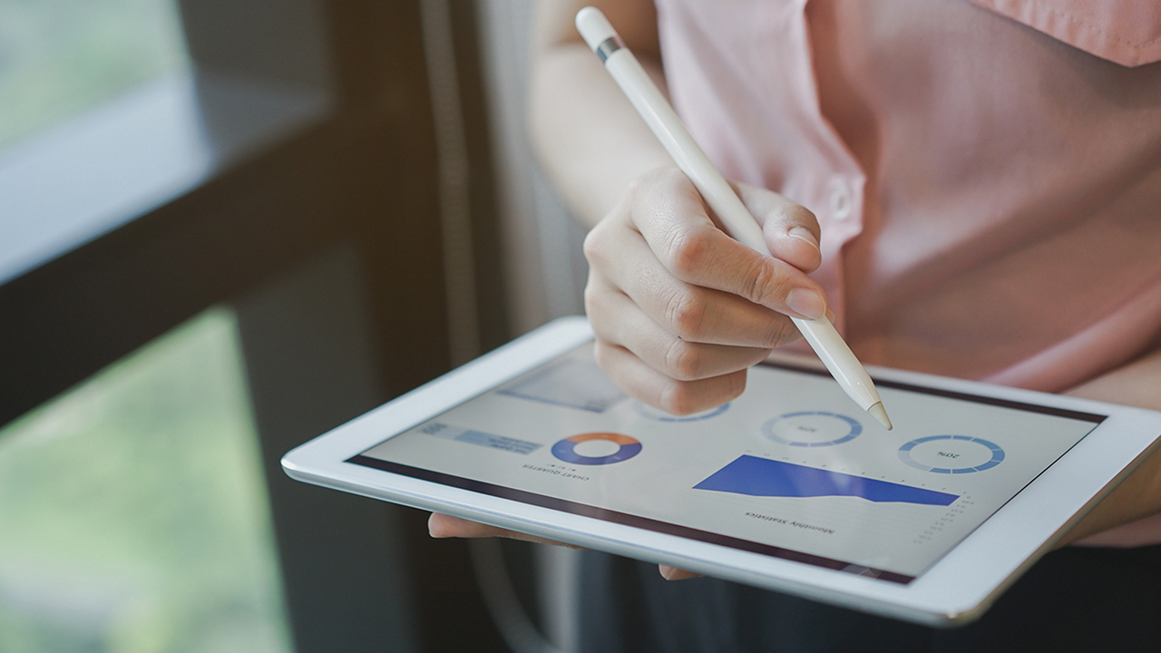 person reviewing data on tablet