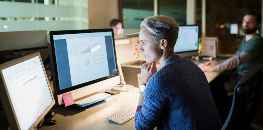 Woman analyzing data on her computer - image