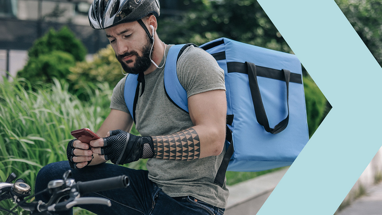 bike courier checking phone payment