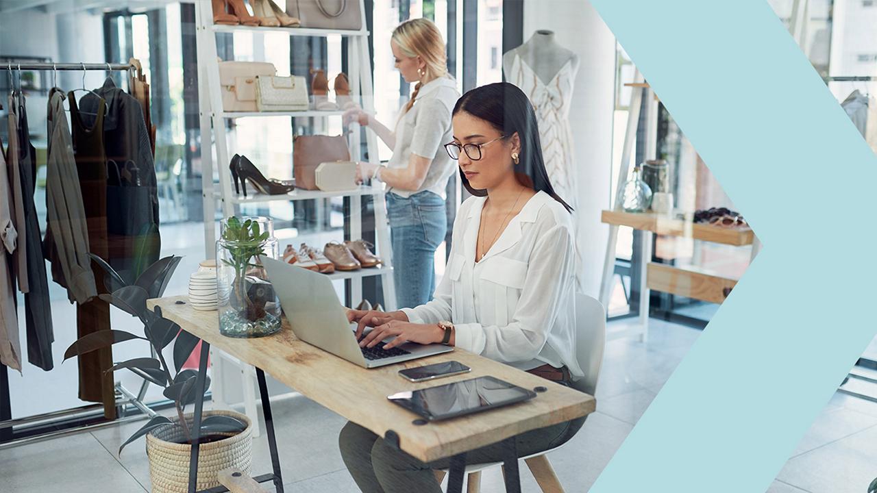 woman shop owner using laptop