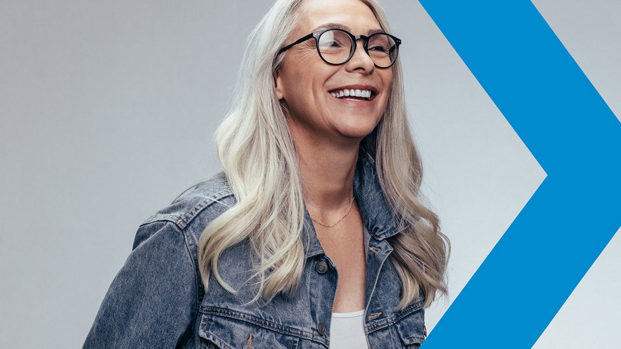 Woman with glasses smiling